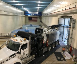 Vacuum truck services inside a hydroelectric dam